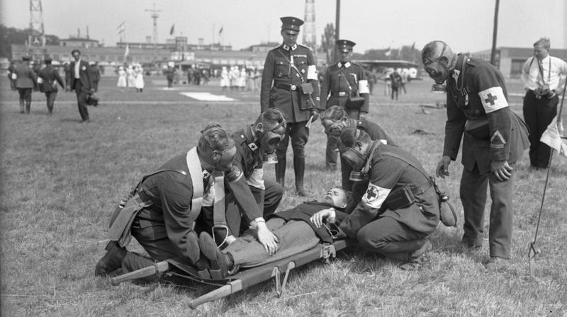 archival photograph of medics working on patient