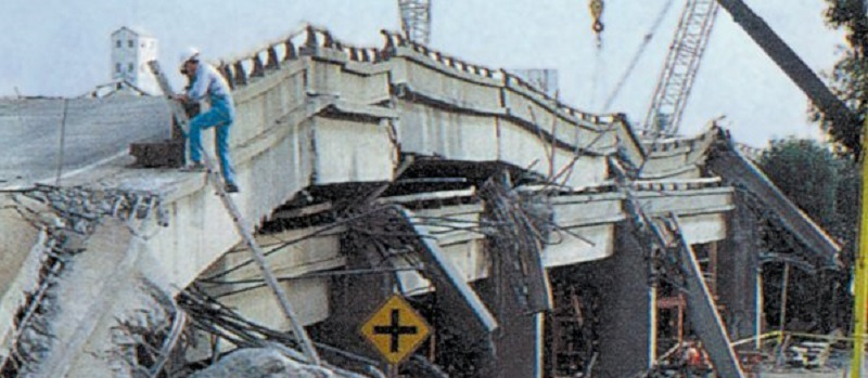 archival photograph of San Francisco-Oakland Earthquake bridge collapse and worker